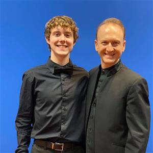 Student, Noah Teer, with All-State 5A Band Director
