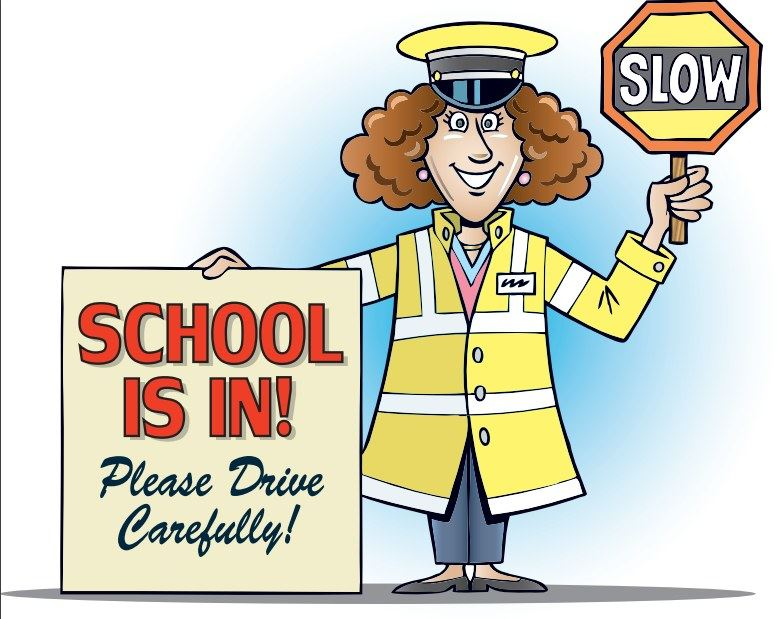 Crossing guard with slow sign and school is in, Please drive carefully sign.