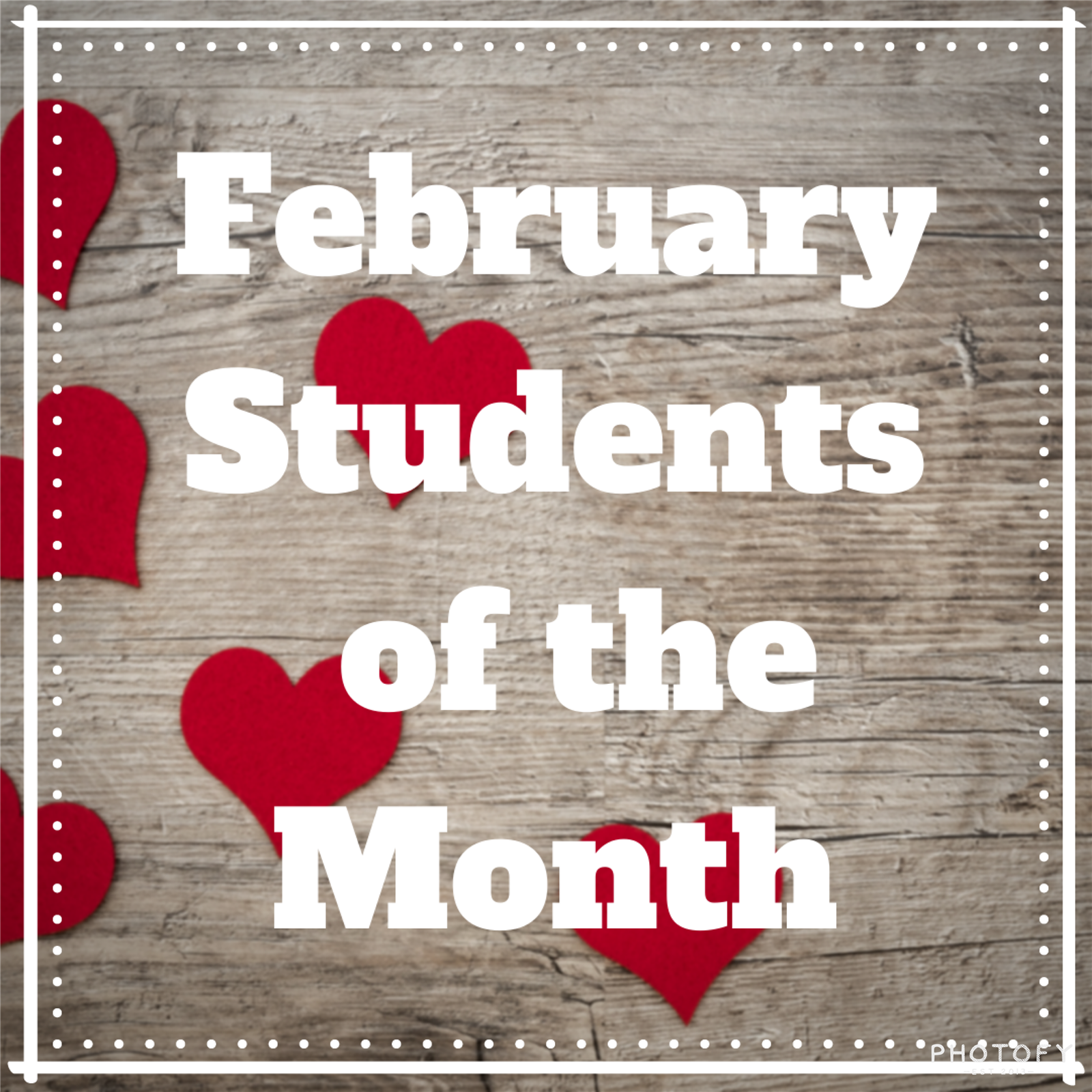 Wooden fence background with red hearts and white words that say February Students of the Month